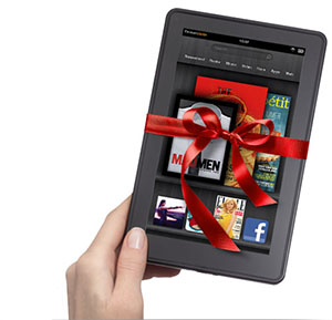 A Kindle Fire wrapped in a red bow.